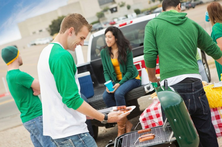 Fans having tailgate cook out at college football stadium
