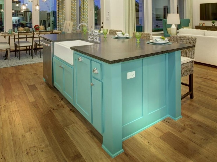 Colorful kitchen island with farmhouse sink