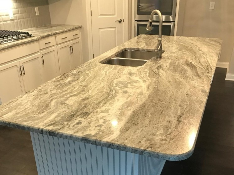Granite-countertop-overlaying-stainless-steel-double-sink