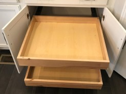 Kitchen base cabinet with pull out drawers