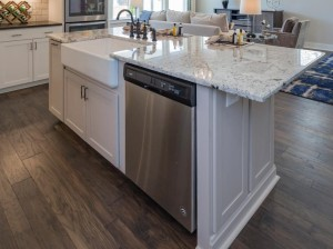 Kitchen island with farmhouse sink and dishwasher