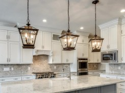 Lantern style pendant lights over kitchen island