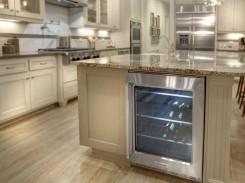 Mini fridge in kitchen island for wine