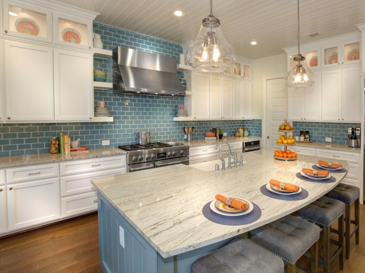 White kitchen cabinets with blue subway tile backsplash
