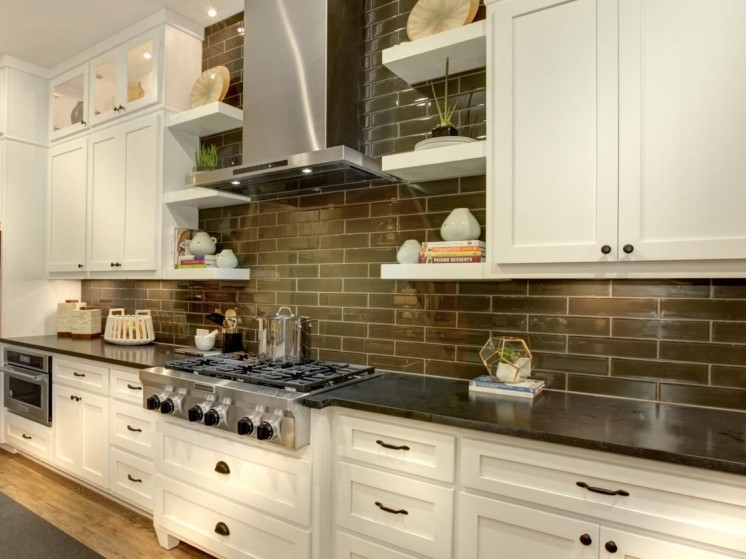 White kitchen cabinets with dark subway tile backsplash