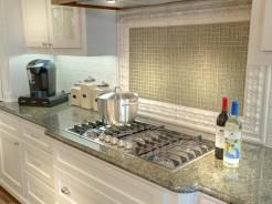White kitchen with green mosaic tile backsplash