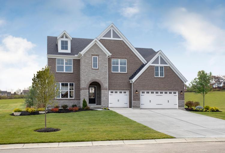 The Bennett floor plan exterior elevation featuring brick and stone by Drees Homes